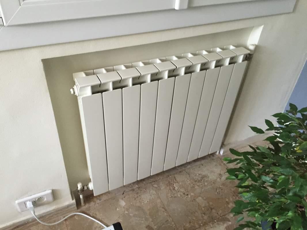 Installation pompe chaleur air eau mitsubishi electric for Radiateur pour chauffage central collectif
